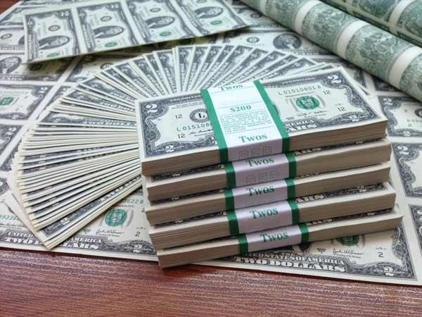 Mơ thấy tiền đô là điềm báo lành hay dữ?